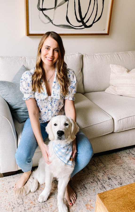 Jen Burch taking comfort from her new dog, Apollo, as she processes the week's events in Afghanistan. Photo courtesy of the author.