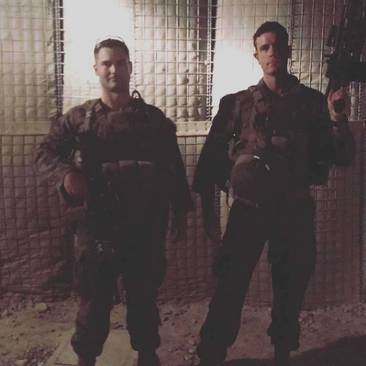 The author and Sgt. Owen Gavagan, a machine gunner who works as a firefighter in his civilian career, as they wait to go out on a foot patrol.