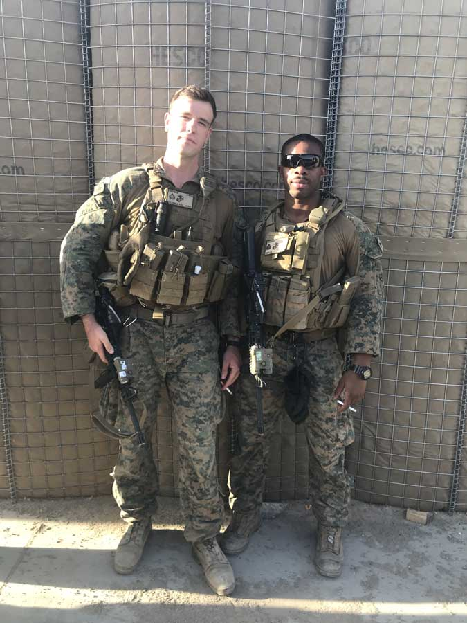The author with Sgt. Cheick Diop, a mortarman, as they get ready for a mounted patrol in Afghanistan. Diop works as a police officer as a civilian.