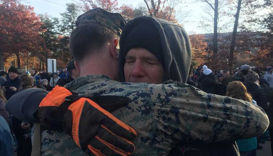 Stephen Caldwell hugs his father, the namesake of his newborn son, after returning home from Afghanistan. Photo courtesy of the author.
