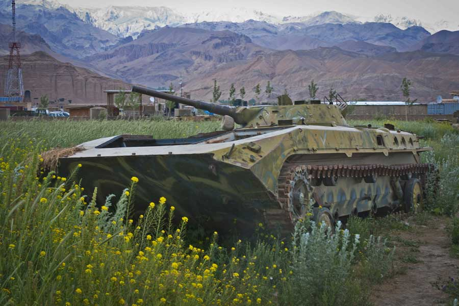 An old Russian tank languishes in a potato field in the Bamyan river valley in Afghanistan in 2012. Photo by Spc. Ken Scar, courtesy of U.S. Army.