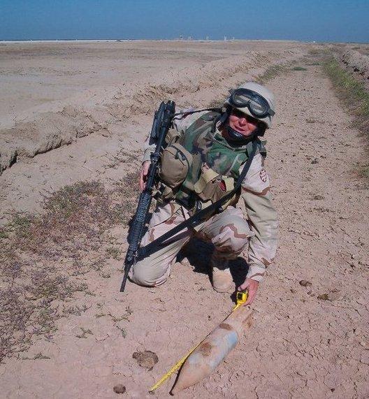 Andrew Myatt documents unexploded ordnance before it's destroyed. Photo courtesy of Andrew Myatt.