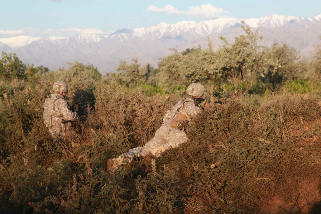 U.S. Army soldiers from Task Force Wolverine take up fight positions in the brush outside the perimeter of Bagram Airfield, Afghanistan, in 2010. Photo by Staff Sgt. Horace Murray, courtesy of U.S. Army.
