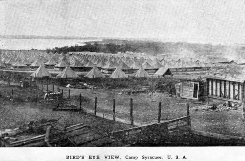 A 1917 photograph of Camp Syracuse, a recruit camp outside Syracuse, New York, shows Onondaga Lake in the background. In 1918, 2,900 of the 12,000 soldiers at Camp Syracuse developed influenza, and 208 died. The virus spread from the camp to Syracuse itself where 900 people died in the fall of 1918. Photo courtesy of New York National Guard.