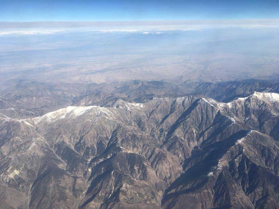 An aircraft flies above the mountains of Afghanistan. Photo courtesy of the author.