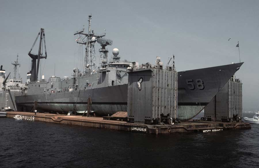 A starboard bow view of the guided missile frigate USS Samuel B. Roberts secured on the deck of the Dutch heavy lift ship Mighty Servant 2. The frigate is returning to its home port for damage repair after striking an Iranian mine while on patrol in the Persian Gulf. Courtesy of the National Archives.