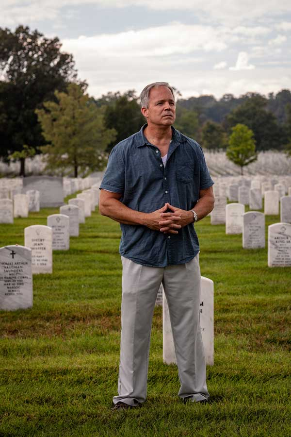 Robert Hogue reflects on the lives lost throughout the global war on terror while walking through Arlington National Military Cemetery. Photo by Eliot Dudik, for The War Horse.