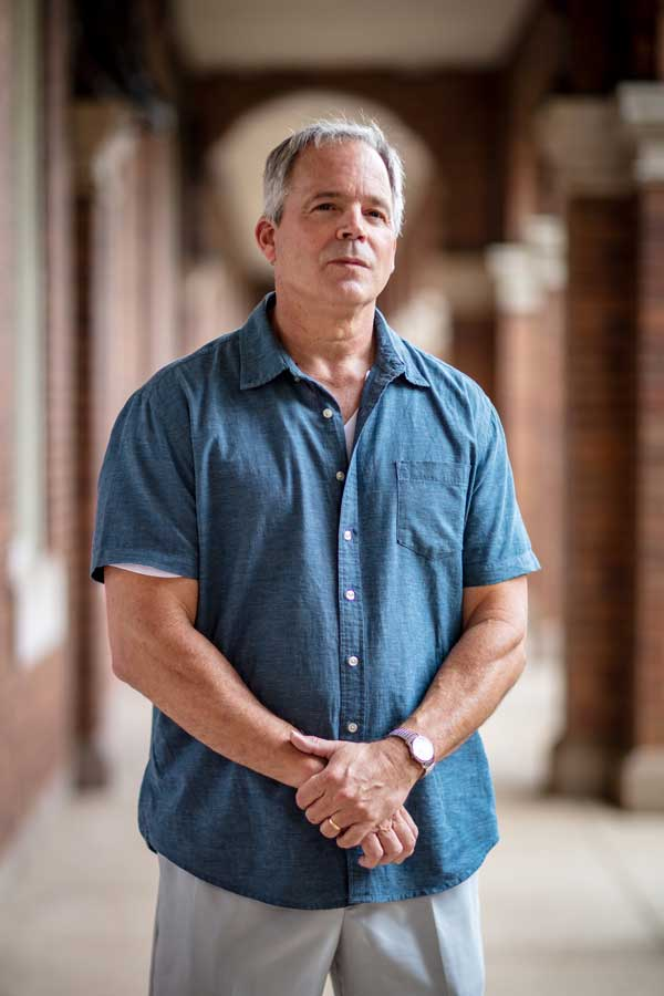 Robert Hogue stands in a hallway used during evening parades at Marine Barracks Washington. Photo by Eliot Dudik, for The War Horse.