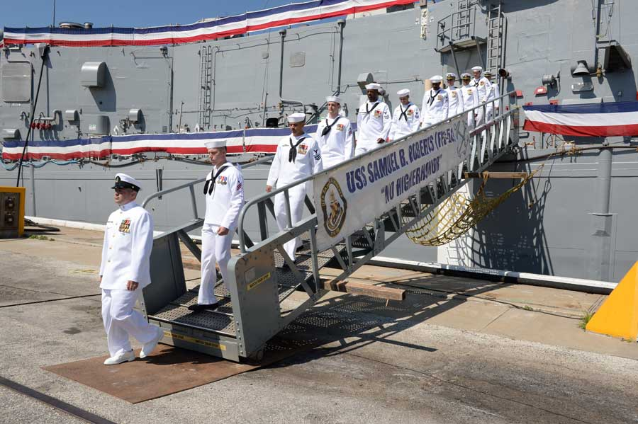 MAYPORT, Florida- Sailors from the guided missile frigate USS Samuel B. Roberts depart the ship for the last time during a decommissioning ceremony at Naval Station Mayport in 2015. The Samuel B. Roberts was commissioned in 1986; its decommissioning marks 29 years of service.