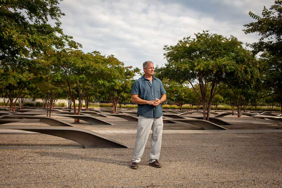 Robert Hogue stands at the center of the Pentagon 9/11 Memorial in Arlington, Virginia. Photo by Eliot Dudik, for The War Horse.