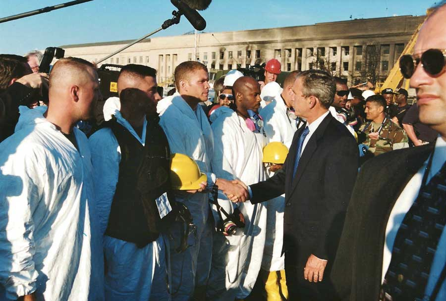Eric Jones shakes the hand of then-President George W. Bush during search-and-rescue efforts at the Pentagon. Photo courtesy of Eric Jones.