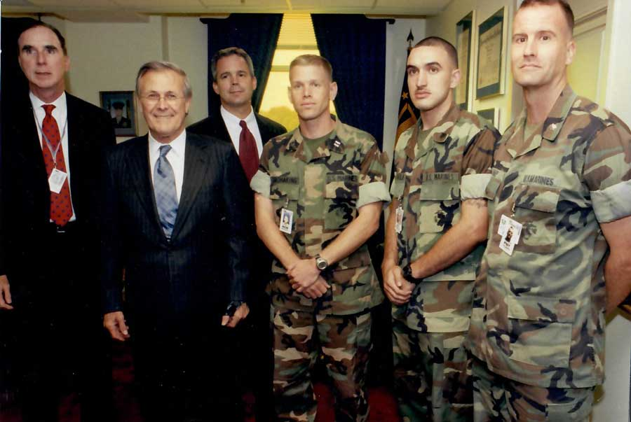 Robert Hogue and Peter Murphy stand with former Secretary of Defense Donald Rumsfeld. Photo courtesy of Robert Hogue.