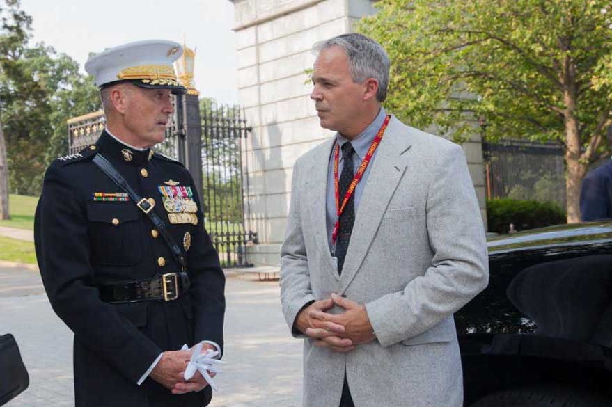 Robert Hogue stands with then-commandant Gen. Joseph Dunford, at Arlington National Military Cemetery. Photo courtesy of Robert Hogue.