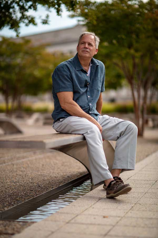 Robert Hogue reflects on the 20th anniversary of the attack while seated at the Pentagon 9/11 Memorial. Photo by Eliot Dudik, for The War Horse.