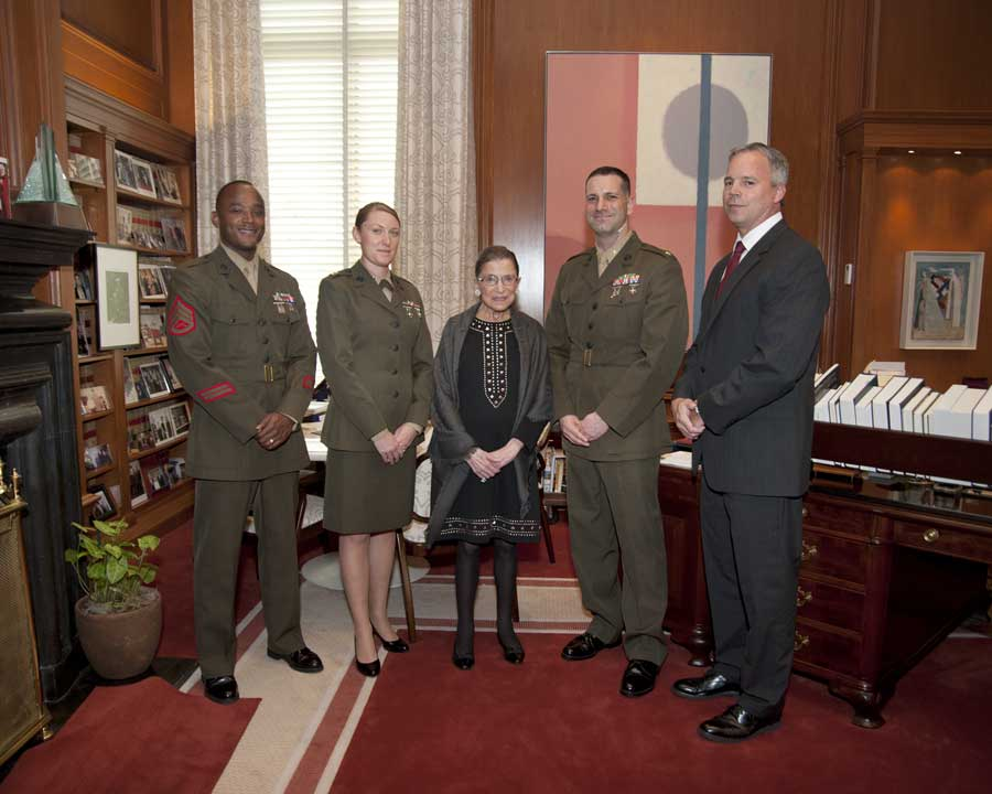 Robert Hogue (right), Capt. Kelly Repair (second from left), and fellow Marines stand beside associate justice Ruth Bader Ginsburg in her chambers at the Supreme Court. Photo courtesy of Robert Hogue.
