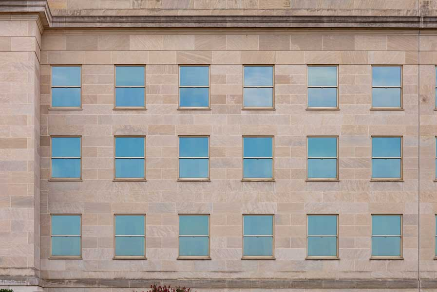 Windows at the Pentagon reflect a cloudy August morning. Photo by Eliot Dudik, for The War Horse.