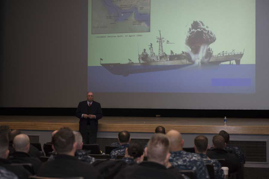 Retired U.S Navy Capt. Paul X. Rinn speaks to junior officers in 2015 in Yokosuka, Japan, about his experience as commanding officer of the Oliver Hazard Perry-class guided missile frigate USS Samuel B. Roberts and its 1988 mining incident. Samuel B. Roberts struck an Iranian mine in the Persian Gulf, and, while under command of Rinn, no loss of life or ship occurred.
