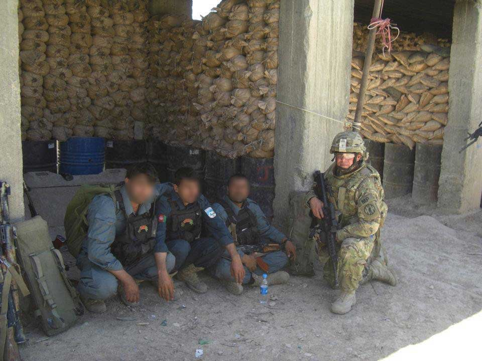 Battle Rattle: Eric Tangeman with three Afghan Uniformed Police officers at an outpost in the Ajuristan District of Ghazni Province, Afghanistan, in 2012.