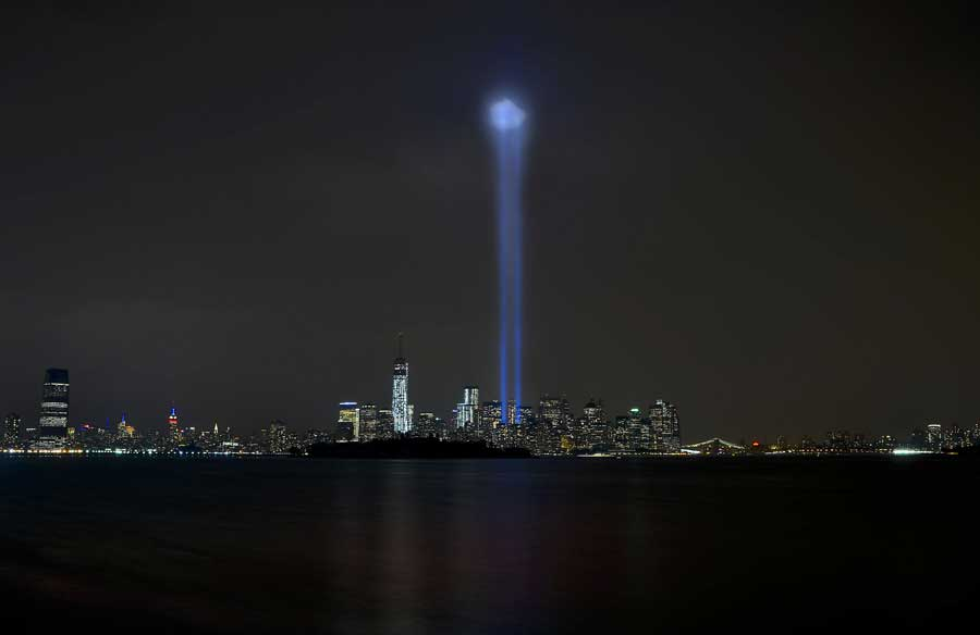 New York City's lower Manhattan skyline and the newly completed One World Trade Center Building are illuminated by two beams of light representing the remembrance of the American citizens lost Sept. 11, 2001. Photo by David Tucker, courtesy of U.S. Air Force.