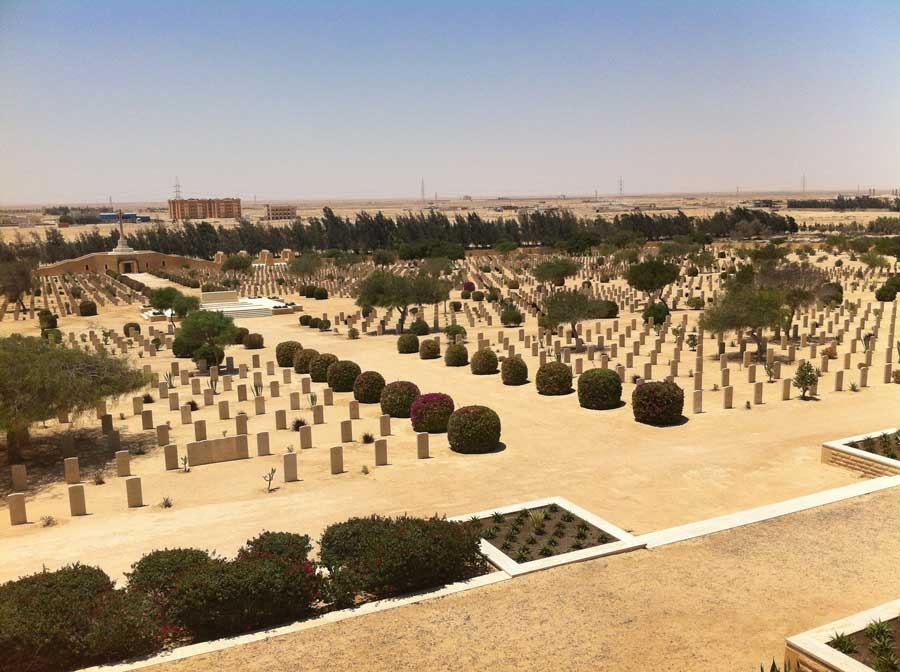 The author snaps a picture of the Al Alamein Cemetery from the a war memorial nearby. Photo courtesy of the author.