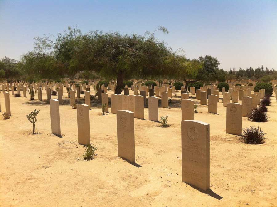 The headstones of those who died in the battles of El Alamein fill a cemetery in Egypt. Photo courtesy of the author.